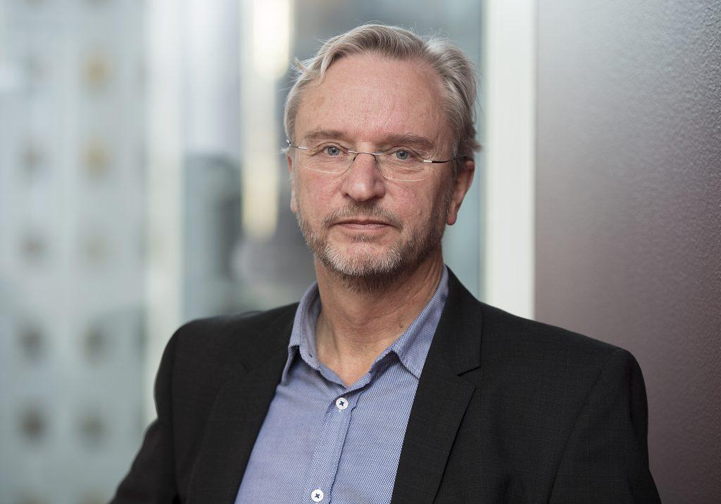 Portrettbilde av Kjell Sunnevåg som er direktør for eksterne relasjoner i Konkurransetilsynet.