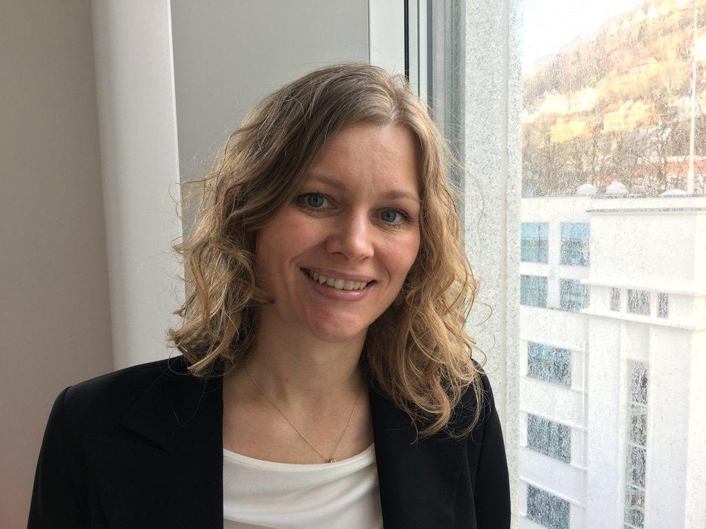Portrettfoto av Katrine Amdam i Konkurransetilsynet.
