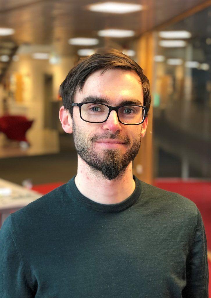 Portrettbilde av Håvard Mork Sandvik, økonom i Konkurransetilsynet.